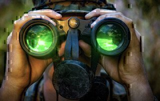 a soldier looking into some optics on a leader recon