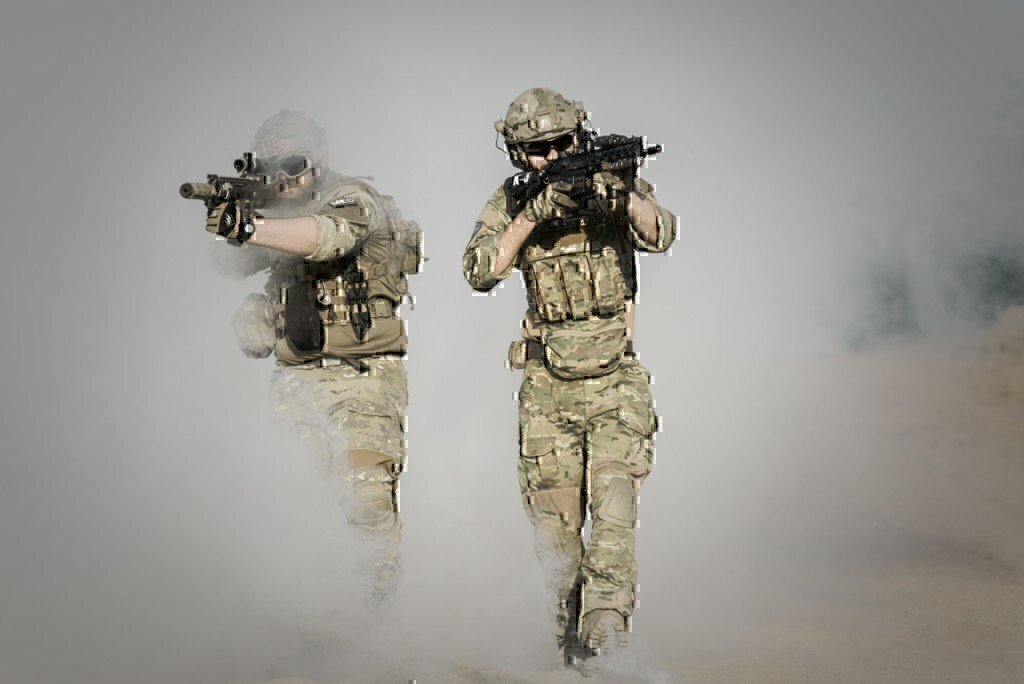 two guys doing action in army uniforms