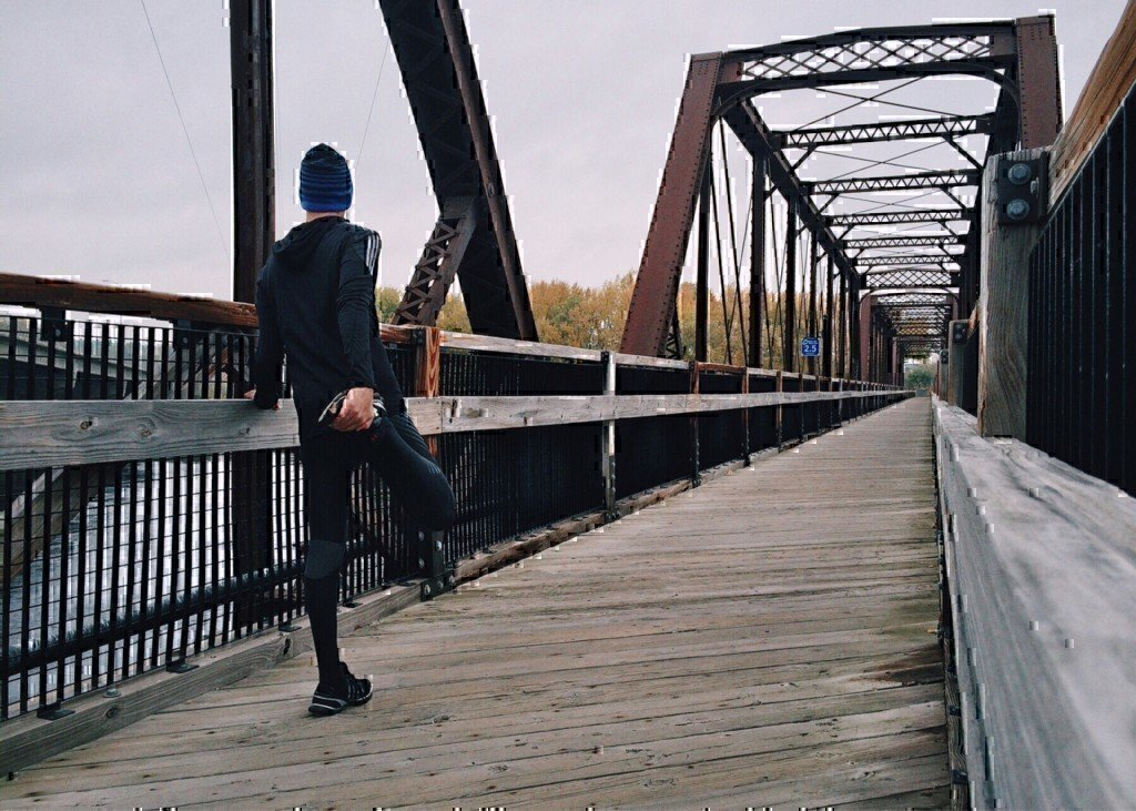 a man on a bridge about to run
