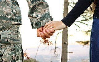 a picture of a couple holding hands