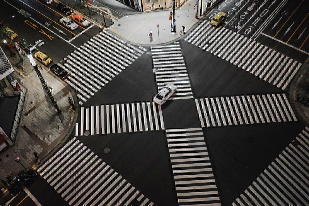 a car going through a crosswalk
