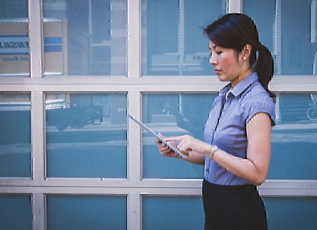 a girl job searching on an ipad