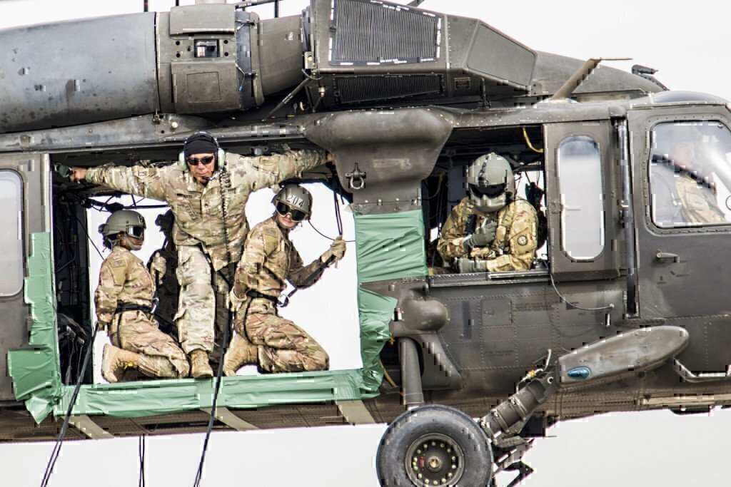 a group of pilots on a black hawk training