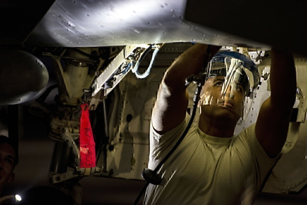 soldier fixing an airplane