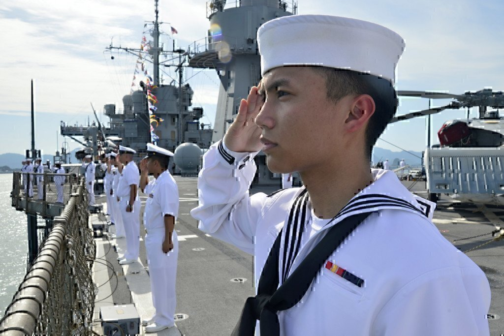 sailors in the navy saluting
