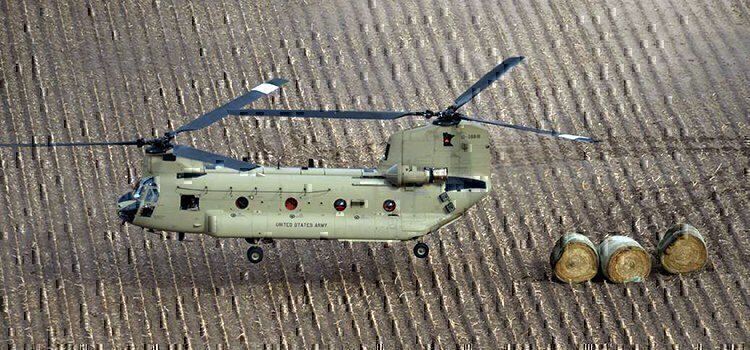 national guard helicopter dropping off hay
