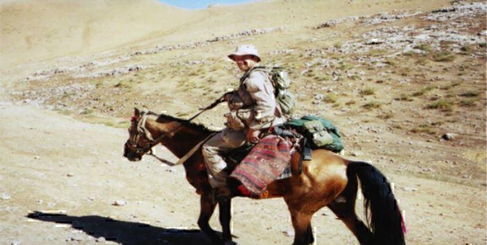 green beret on horseback