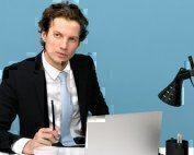 a man on a laptop looking professional