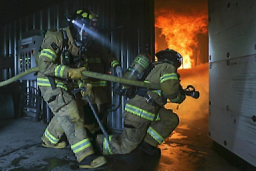 firefighters working and training