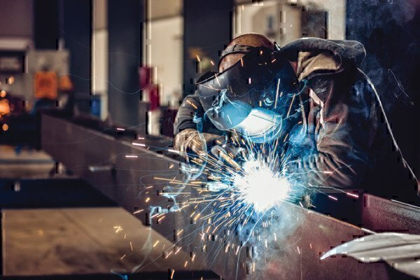 a welder working on some material