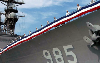 a navy ship showing its designations