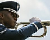 an airman playing a trumpet