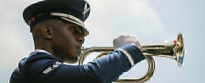an airman playing a trumpet