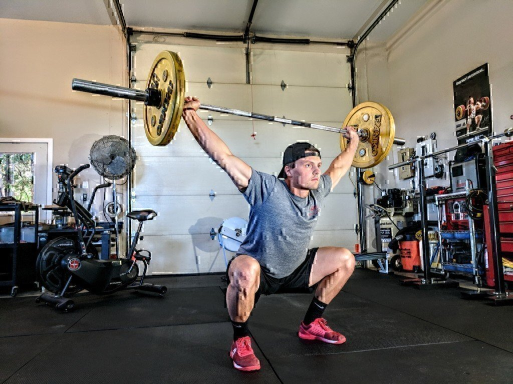 a man doing barbell exercises