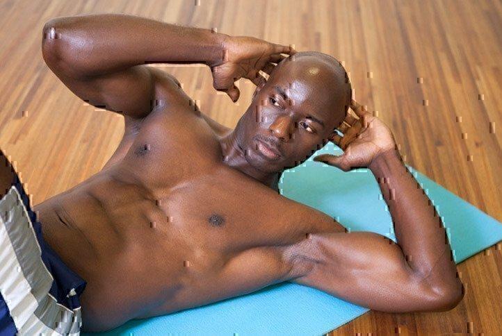 man-doing-crunches-floor-mat