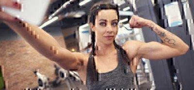 woman-taking-selfie-in-gym