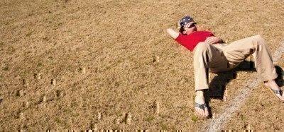 man-sleeping-in-field
