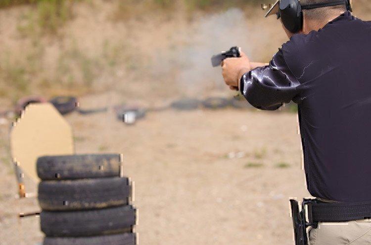 man-shooting-pistol-training