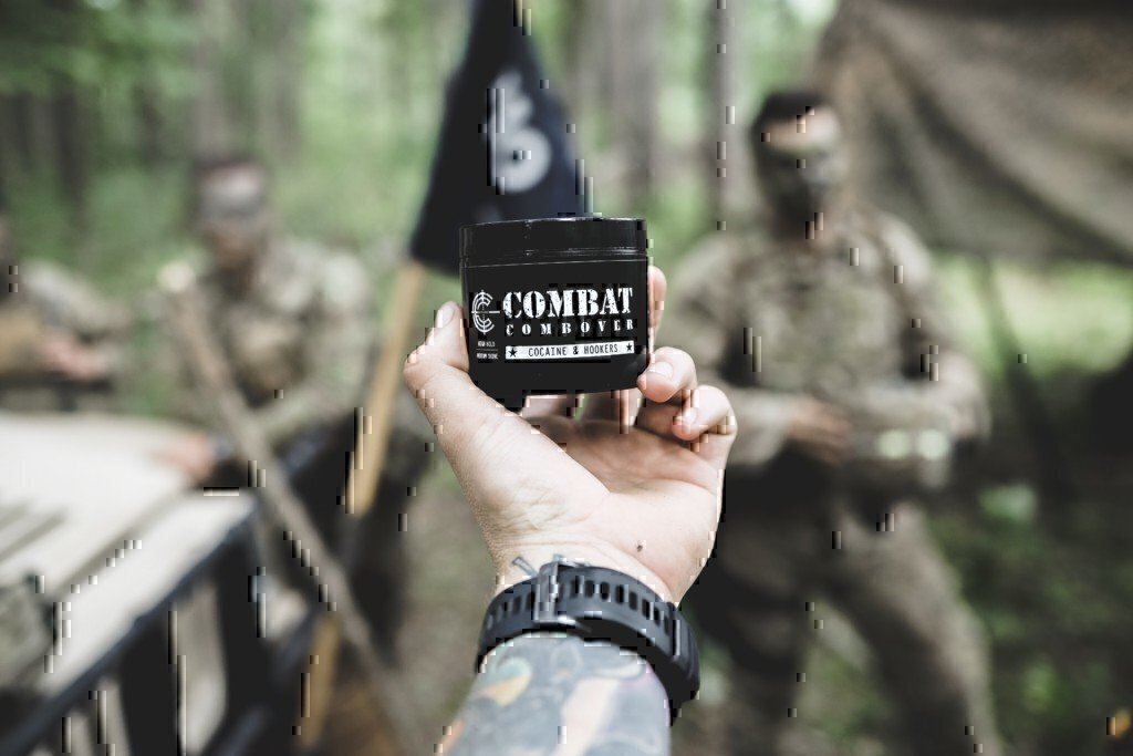 a soldier holding a jar of pomade