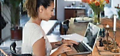 female-student-working-on-laptop
