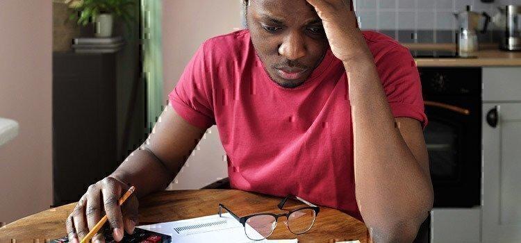 anxious-man-paying-bills