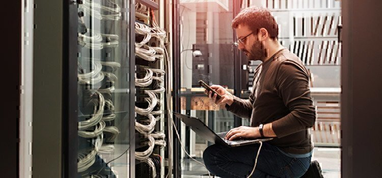 man-working-on-internet-server