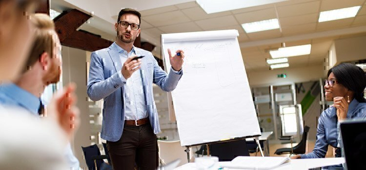 man-giving-presentation-in-meeting