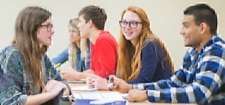 college-students-talking-in-classroom