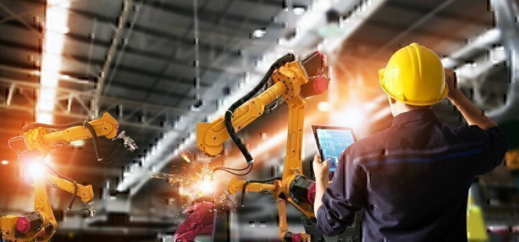 man-in-factory-controlling-machinery-with-tablet