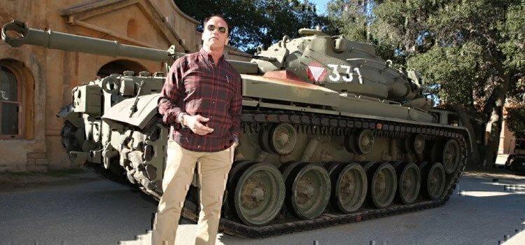 arnold-schwarzenegger-standing-in-front-of-his-tank