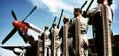 service-members-with-ammo-belts-standing-in-front-of-planes