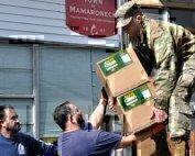 national-guardsman-distributing-hand-sanitizer