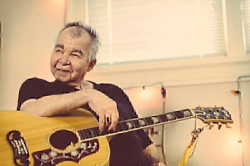 john-prine-with-his-guitar
